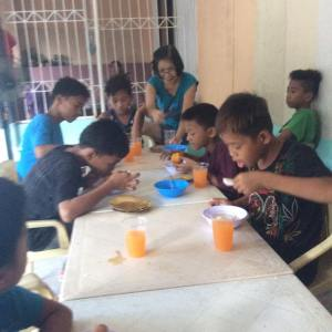 feeding street kids in the Philippines